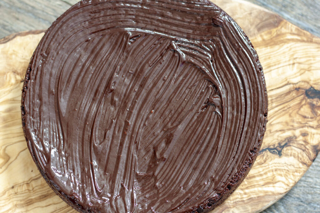 Vegan chocolate covered cake with frosting